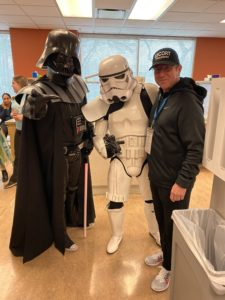 Marc Dias with volunteers dressed up in Star Wars costumes.