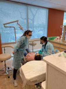 Doctors and student doctors provide dental services to underserved kids.